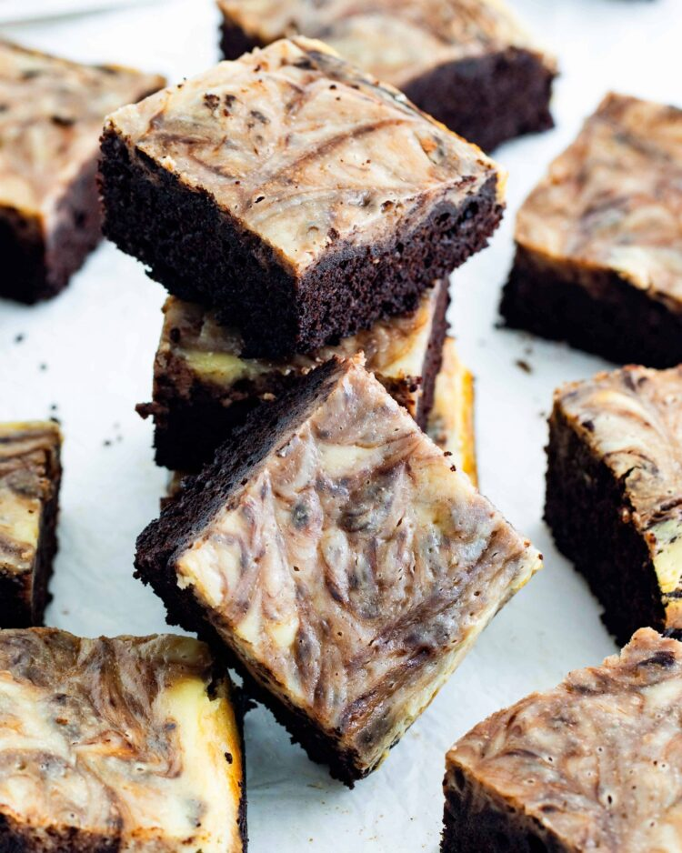scattered cream cheese brownies with a few stacked