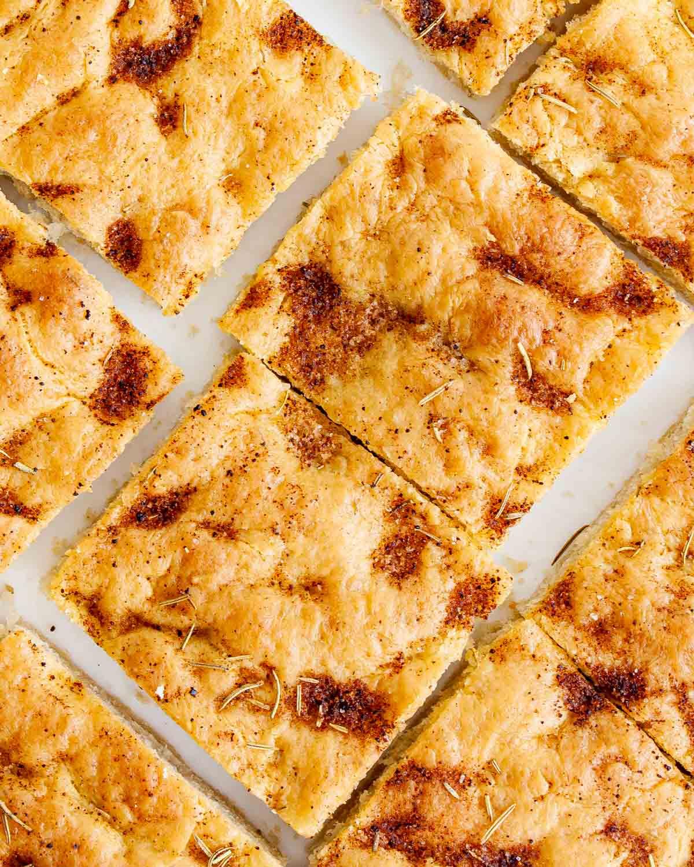 overhead shot of focaccia bread cut into slices
