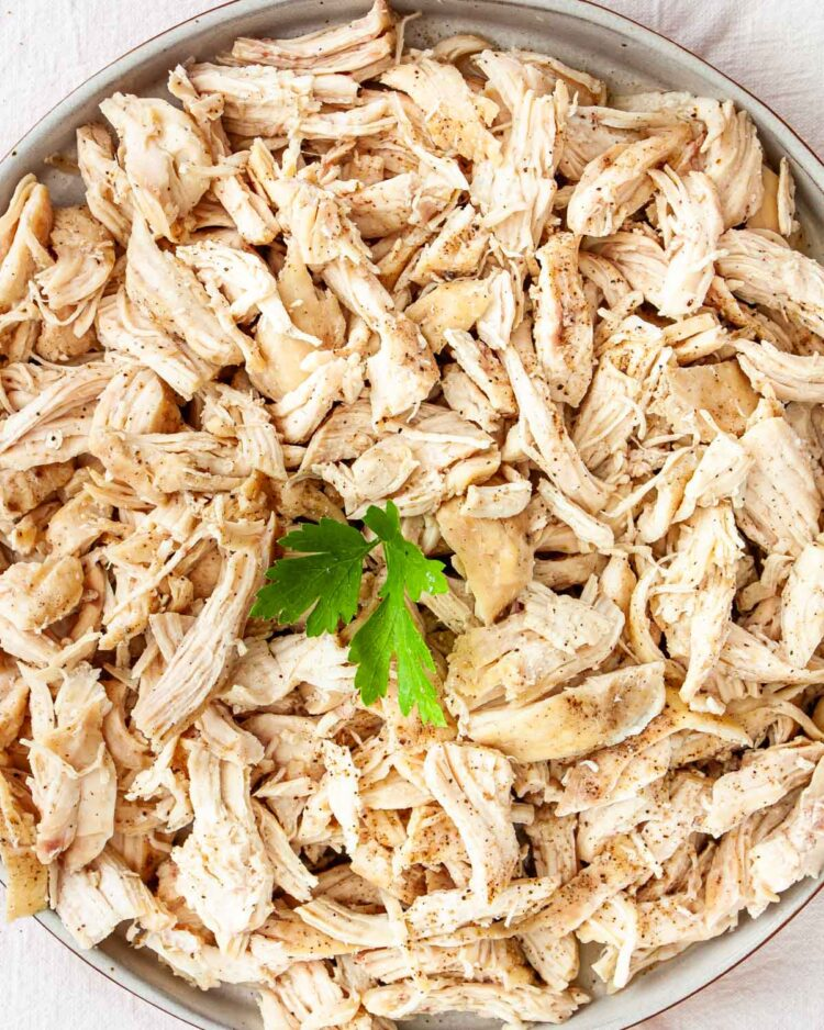 overhead shot of shredded chicken on a plate