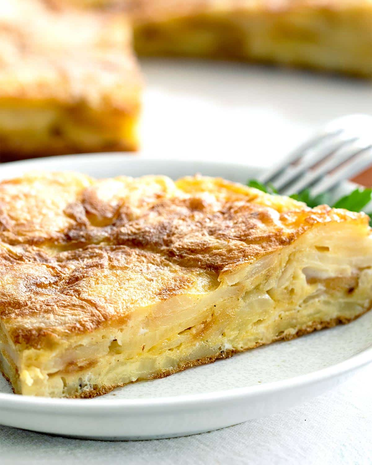 a slice of spanish tortilla on a plate.