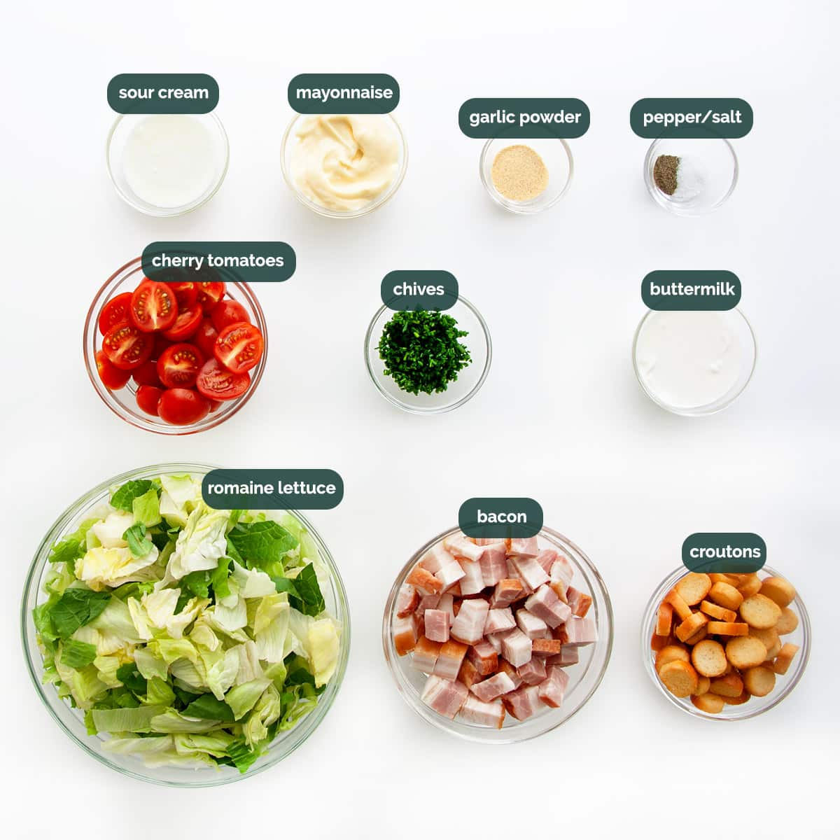 overhead shot of all ingredients needed to make a blt salad.