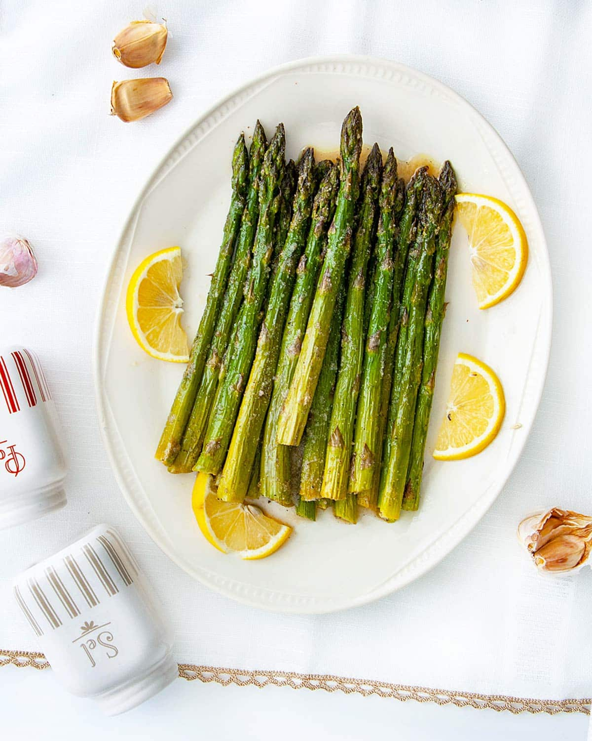 overhead of roasted asparagus on a serving platter.