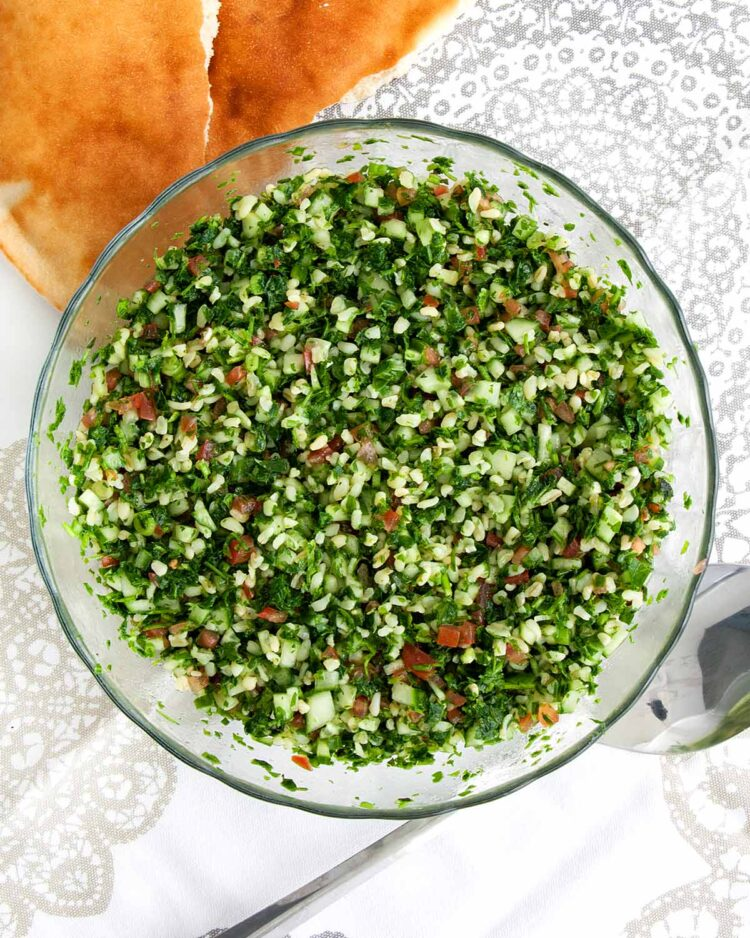 overhead shot of tabbouleh salad freshly made in a bowl.