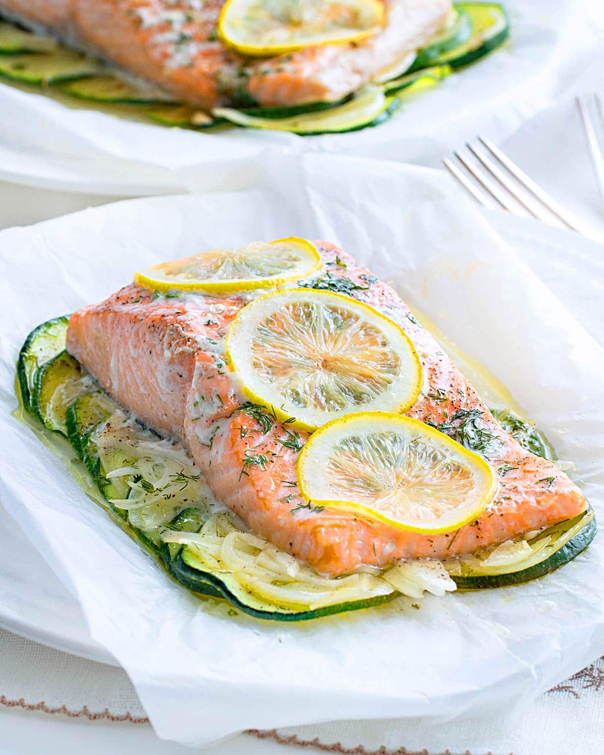 baked salmon fillet with veggies on a plate.