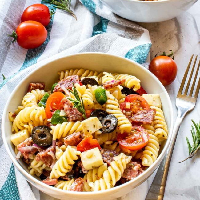italian pasta salad in 2 white bowls.