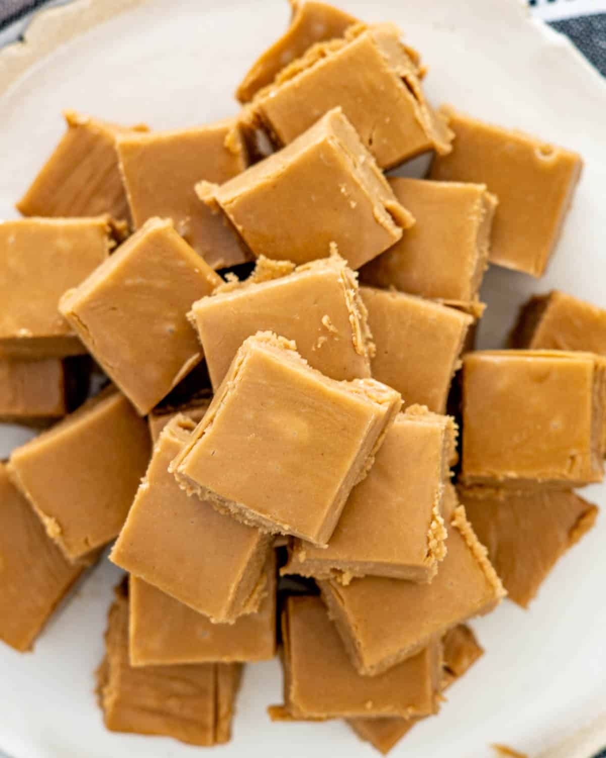 overhead shot of peanut butter fudge pieces on a plate.