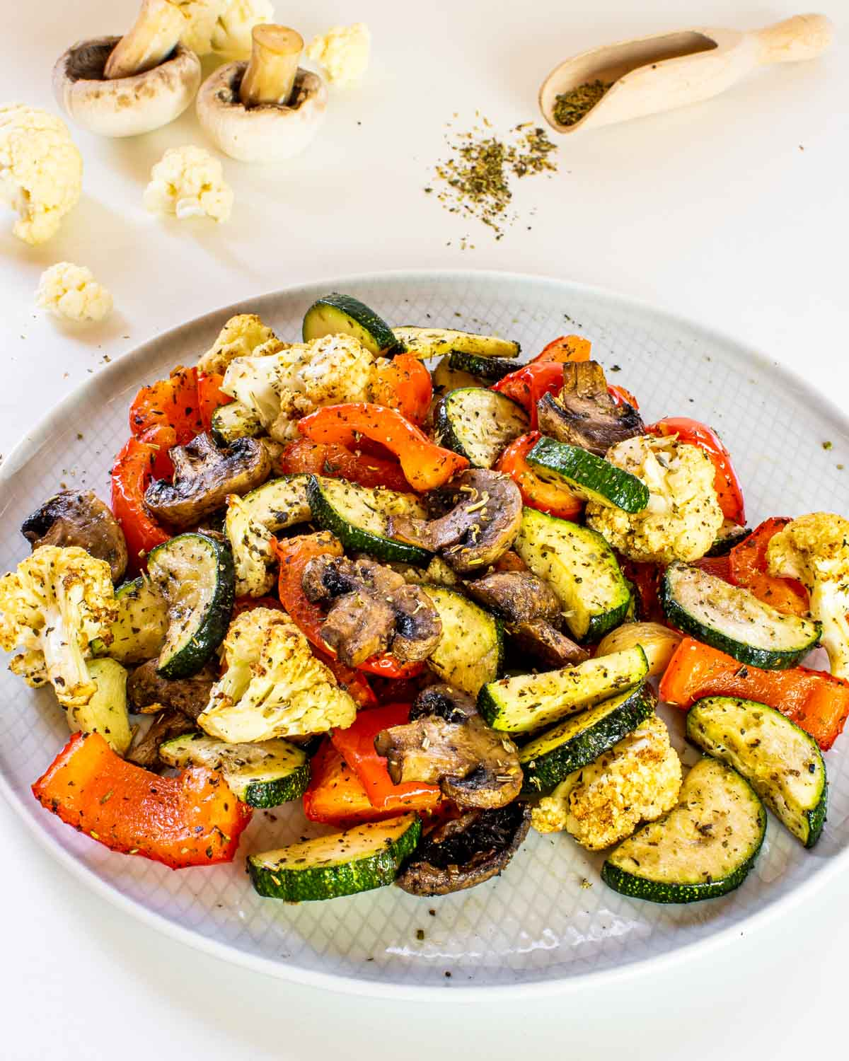 roasted vegetables made in the air fryer on a white plate.