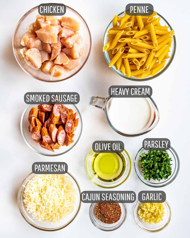 overhead shot of ingredients needed to make cajun chicken alfredo.