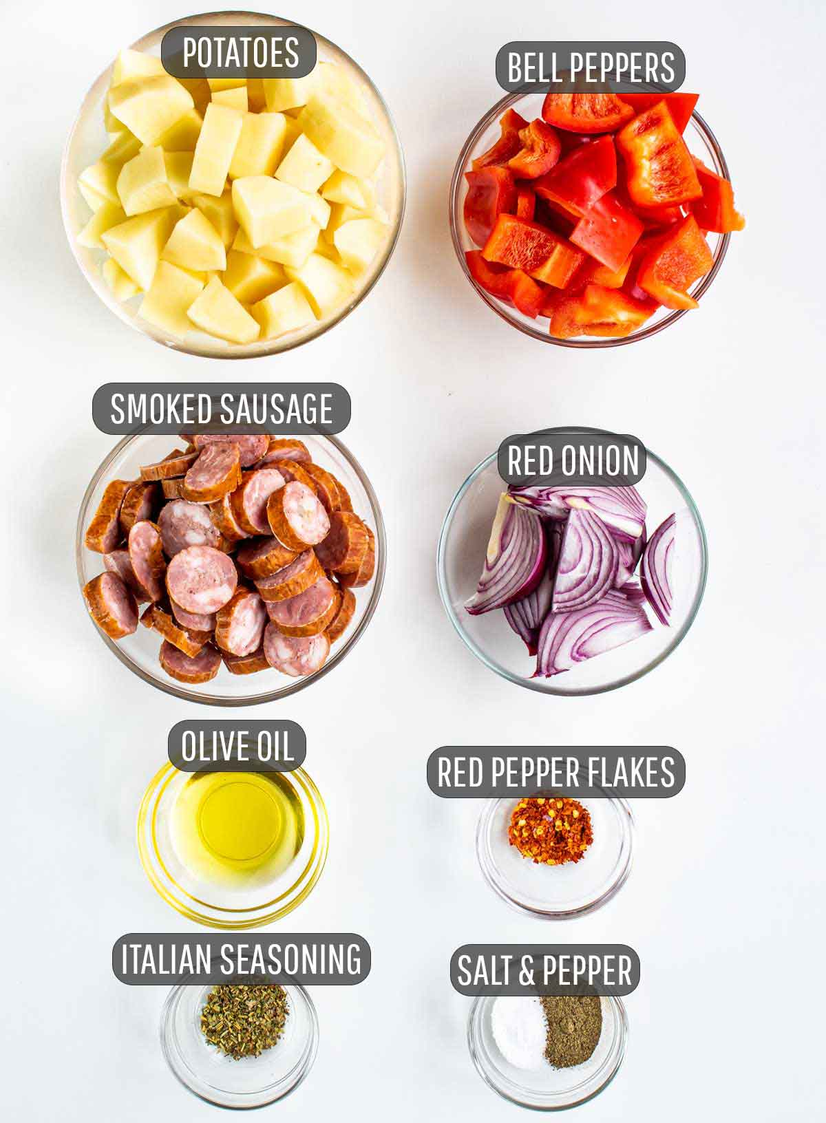 overhead shot of ingredients needed to make roasted potatoes and sausage.