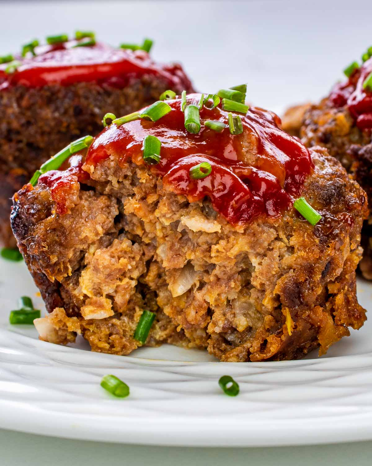 closeup of the inside of a meatloaf muffin with ketchup.