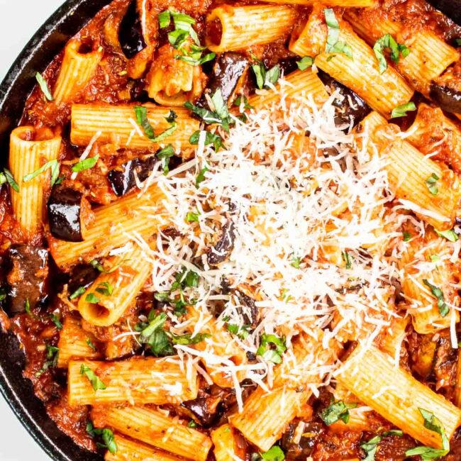 freshly made pasta alla norma in a black skillet.