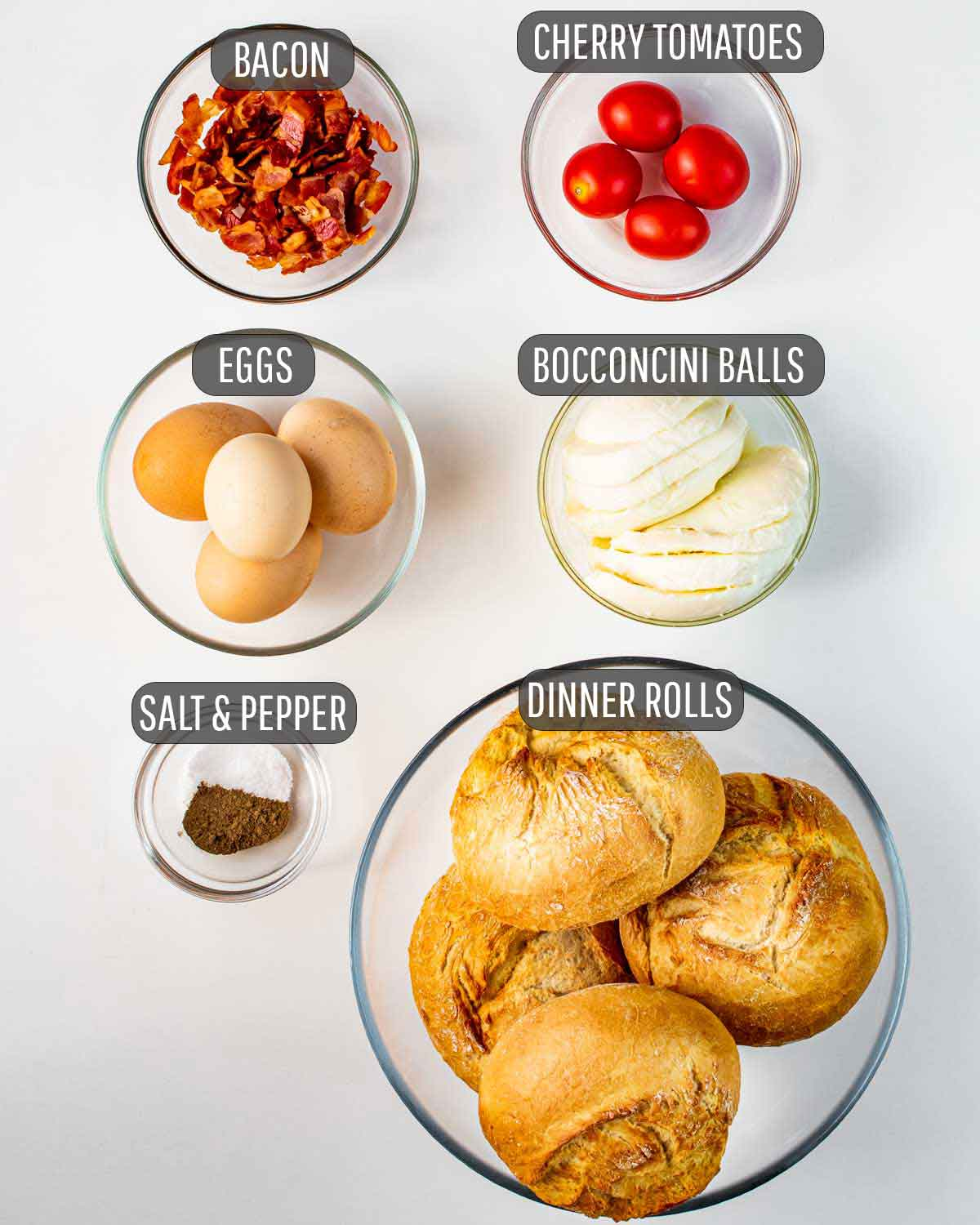 overhead shot of all the ingredients needed to make eggs and bacon breakfast bowls.